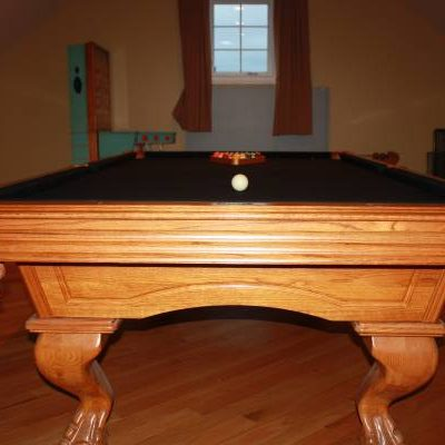 Black Pool Billiards Table With Stand and Pool Sticks
