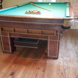 Antique Brunswick Pool table with accessories